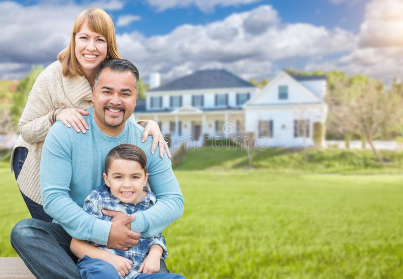 Mixed Race Family Portrait In Front of House. Happy Mixed Race Hispanic and Caucasian Family Portrait In Front of House stock photography