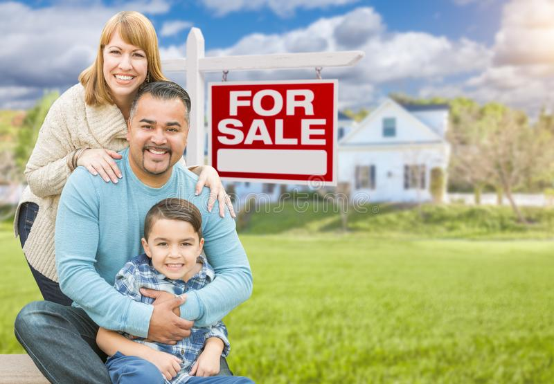 Mixed Race Family Portrait In Front of House and For Sale Real E. Happy Mixed Race Hispanic and Caucasian Family Portrait In Front of House and Sold For Sale royalty free stock images