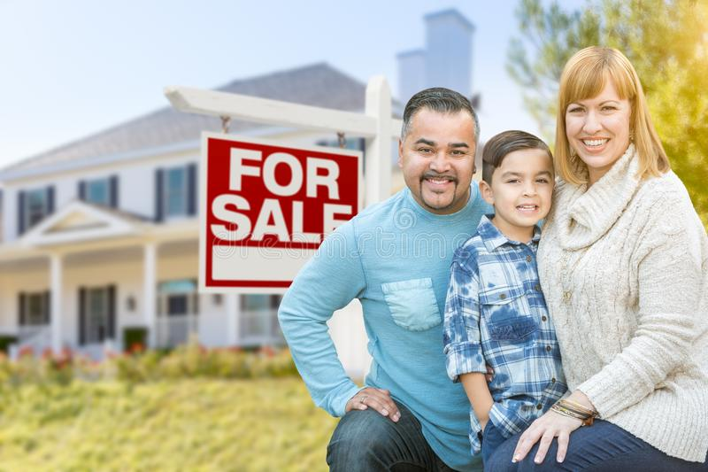 Mixed Race Family Portrait In Front of House and For Sale Real E. Happy Mixed Race Hispanic and Caucasian Family Portrait In Front of House and Sold For Sale stock images