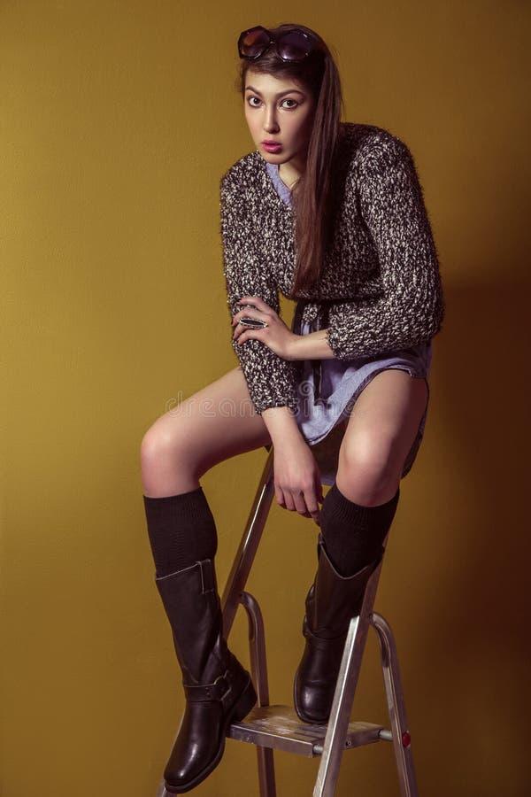 Free Mixed Race Fashion Model Posing On Stepladder. Royalty Free Stock Image - 73002386