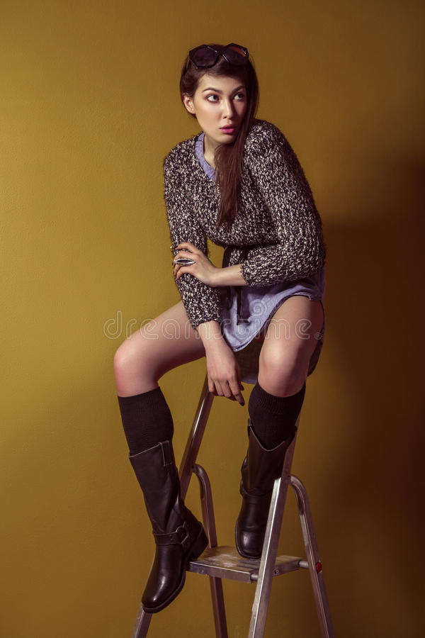 Free Mixed Race Fashion Model Posing On Stepladder. Stock Images - 73003984