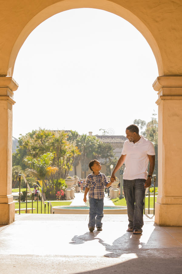 Mixed Race Father and Son Walking in the Park stock image