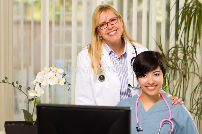 Download Mixed Race Female Doctors Or Nurses In Office Stock Photo - Image: 18618270