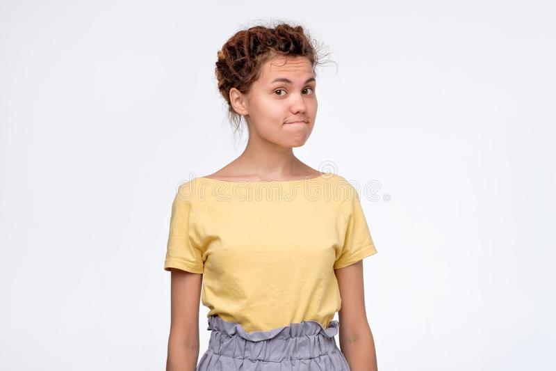 Mixed race female looking at camera with distrust, eyes full of disappoinment. Serious young mixed race female looking at camera with distrust, her eyes full of royalty free stock photography