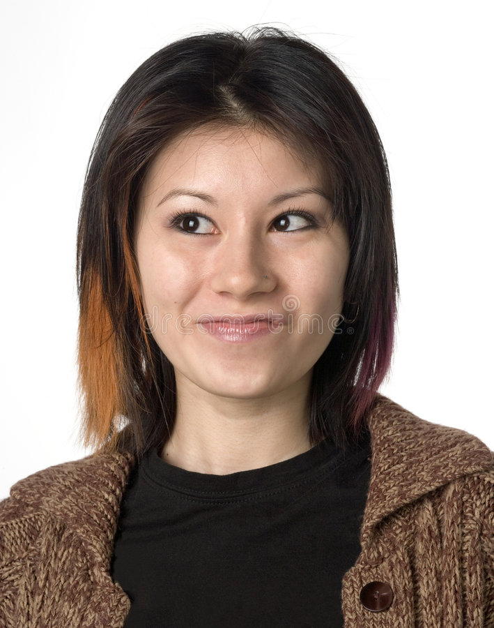 Mixed race female portrait with quirky expression stock photography