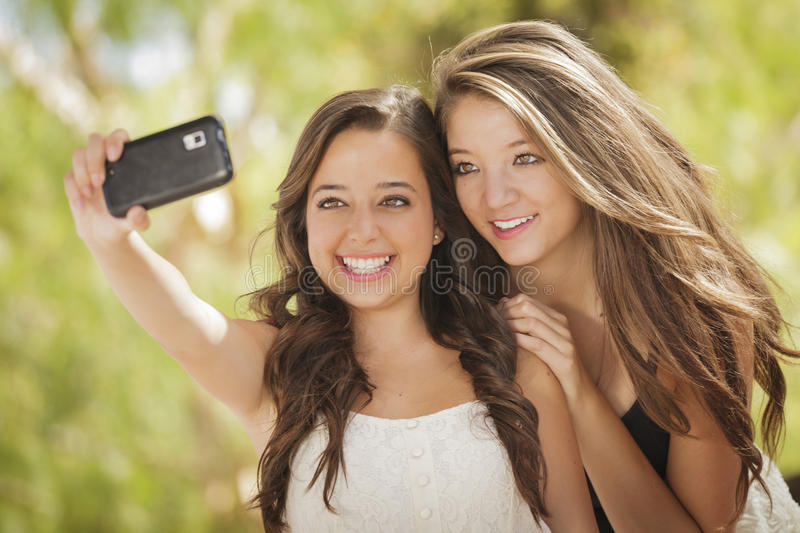 Mixed Race Girlfriends Self Portrait with Camera stock photo