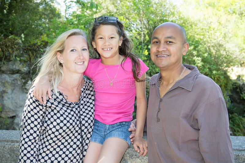 Mixed-race Happy family with little daughter girl in country stock photography