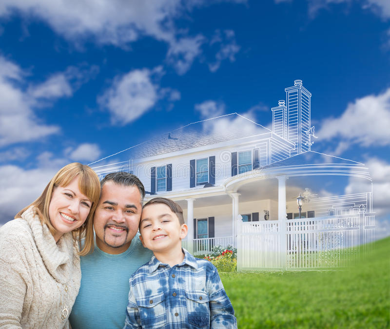 Mixed Race Hispanic and Caucasian Family In Front of Ghosted House Drawing on Grass. Mixed Race Hispanic and Caucasian Family In Front of a Ghosted House stock photo