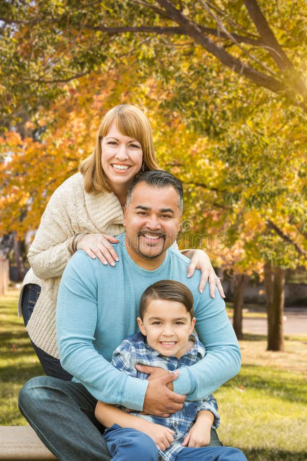 Mixed Race Hispanic and Caucasian Family Outdoor Portrait at the Park. Happy Mixed Race Hispanic and Caucasian Family Portrait at the Park stock photography