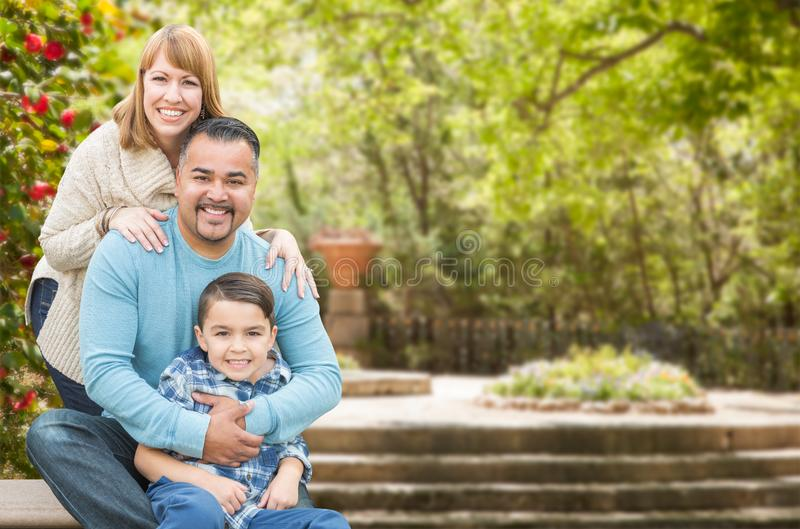 Mixed Race Hispanic and Caucasian Family Portrait at the Park. Happy Mixed Race Hispanic and Caucasian Family Portrait at the Park royalty free stock image