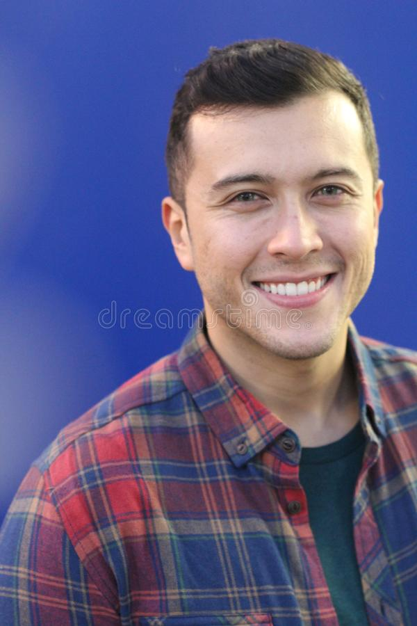 Mixed race man with blue eyes smiling royalty free stock photography