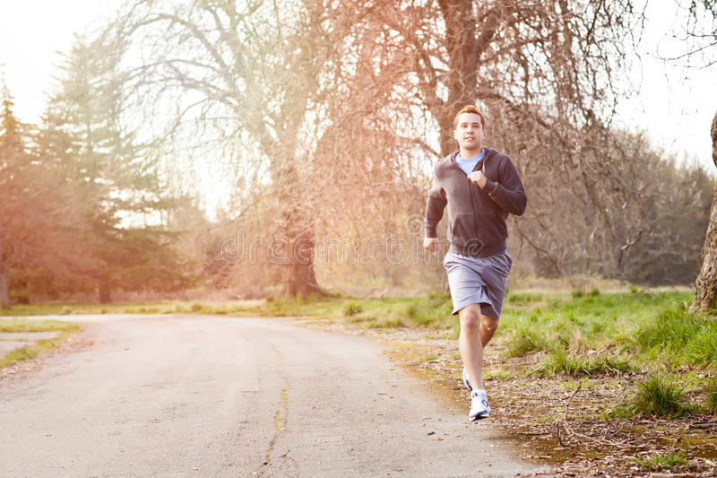 Mixed race man running stock images