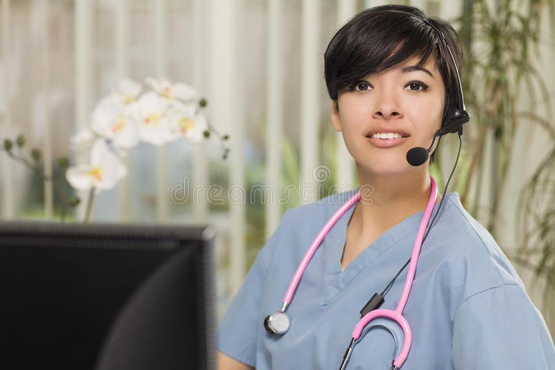 Mixed Race Nurse Practitioner or Doctor at Computer royalty free stock photo