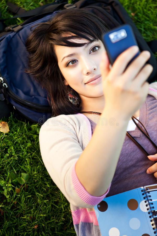 Mixed race student texting royalty free stock images