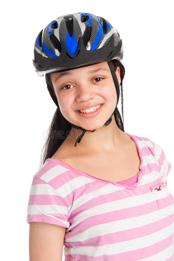 Mixed Race Teenage Girl Wearing a Bicycle Helmet. Teenage girl wearing a bicycle helmet. Isolated on white studio background stock photography