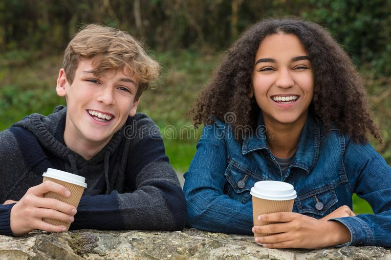 Mixed Race Teenagers Boy & African American Girl Drinking Coffee stock photography
