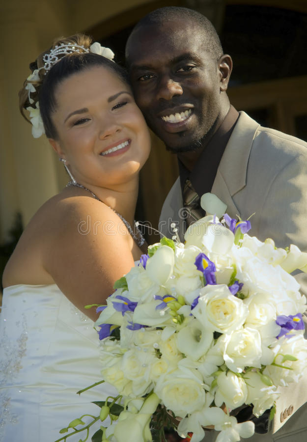 Mixed race wedding couple stock image