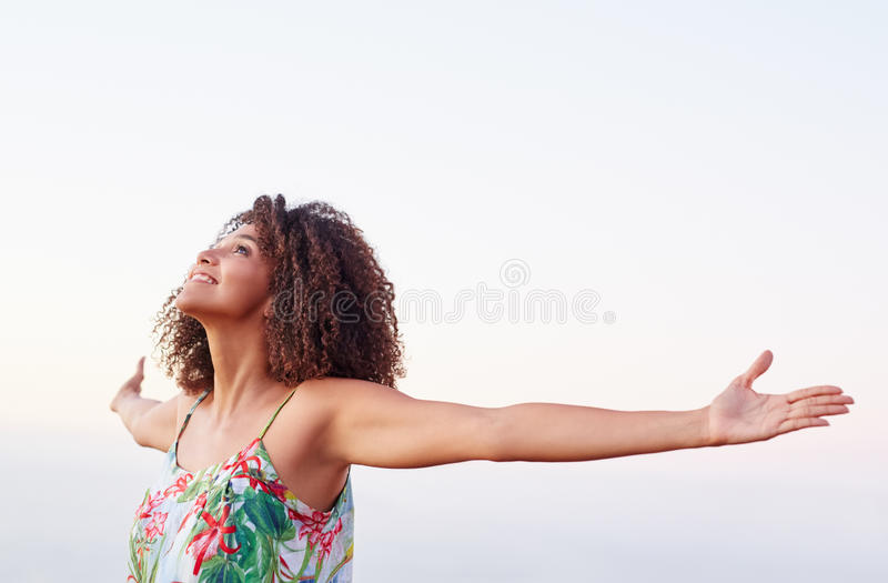 Mixed race woman expressing freedom outdoors stock images