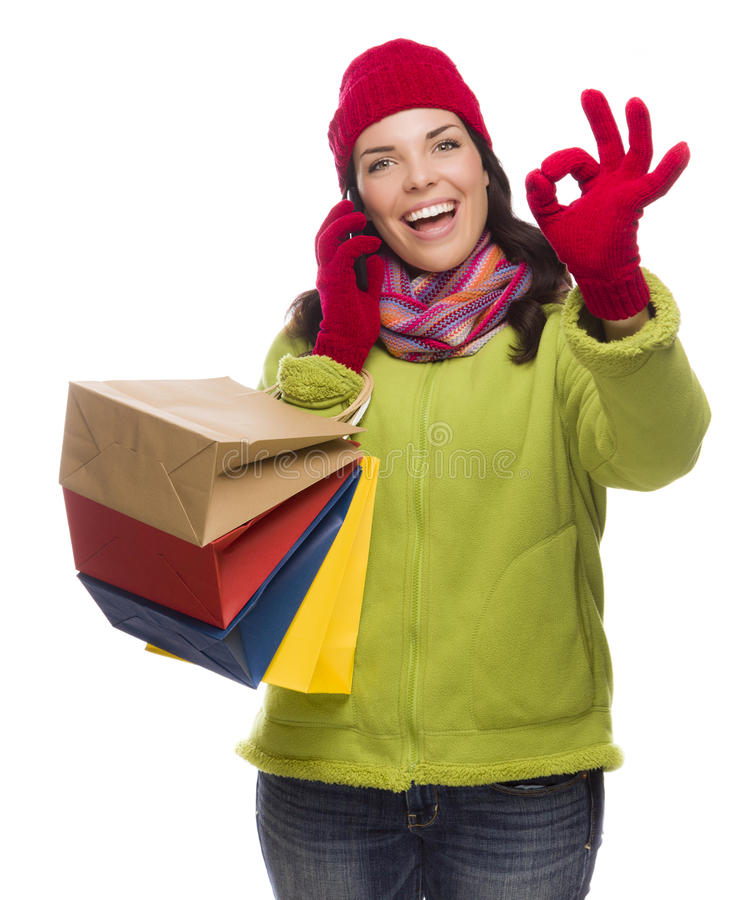 Mixed Race Woman Holding Shopping Bags On Phone Ok Gesture royalty free stock photo