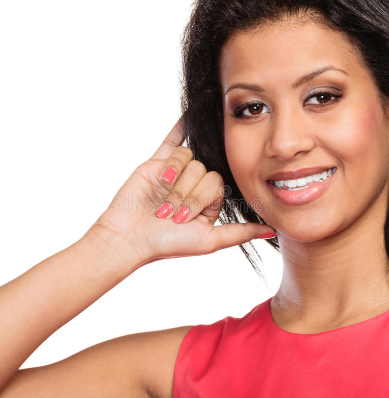 Mixed race woman showing call me gesture. stock photos