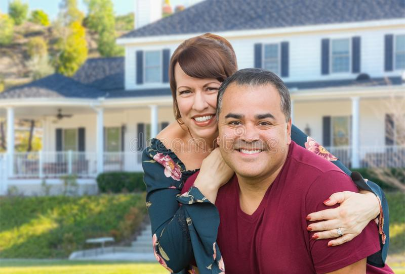 Mixed Race Young Adult Couple Portrait In Front of Beautiful House royalty free stock image