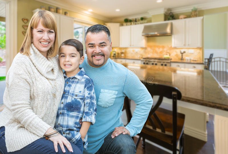 Mixed Race Young Family Inside Kitchen of House. Happy Mixed Race Young Family Inside Beautiful Kitchen of Their House stock image