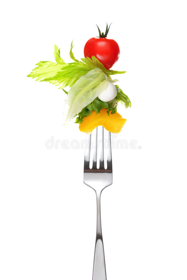 Mixed salad on fork stock image