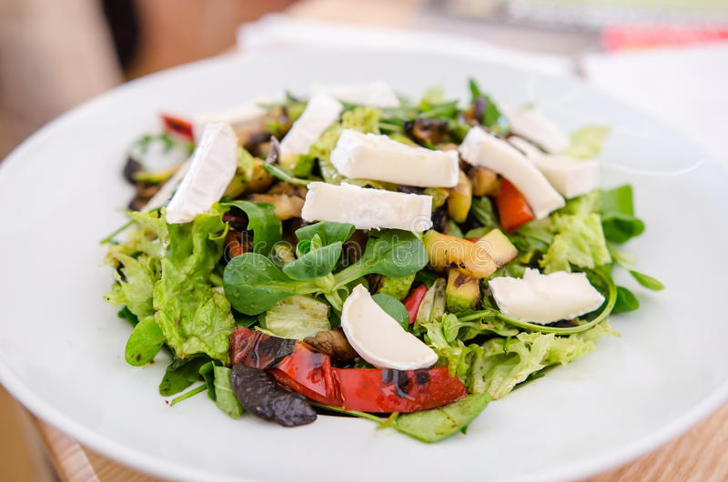 Mixed salad with goat cheese and roasted vegetables royalty free stock images