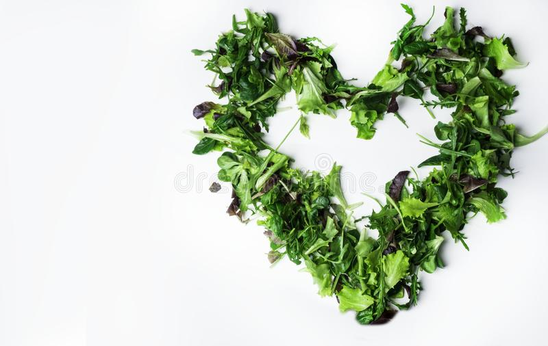 Mixed salad leaf. Lettuce spinach isolated on white background, heart shape from greenery royalty free stock photos