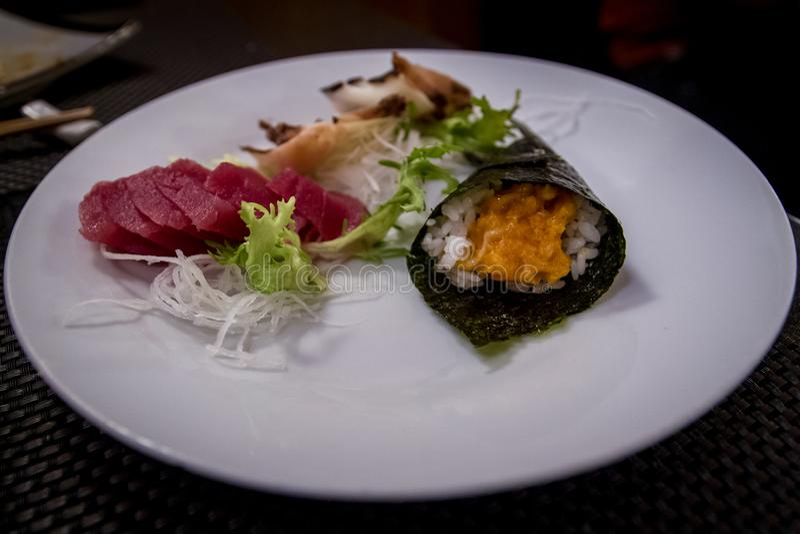 Mixed sashimi and sushi at the japanese restaurant royalty free stock photography