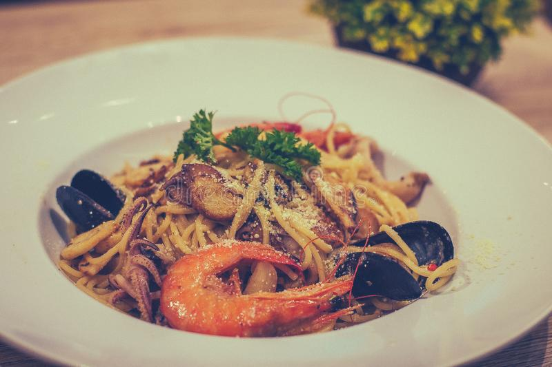 Mixed Seafood Aglio prawn squid mussel mushroom. Mixed Seafood Aglio with prawn squid mussel mushroom royalty free stock images
