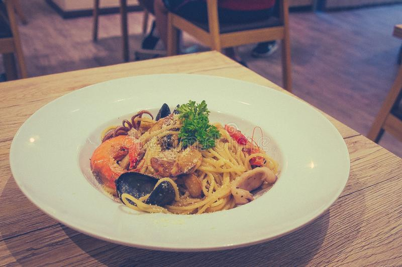 Mixed Seafood Aglio prawn squid mussel mushroom. Mixed Seafood Aglio with prawn squid mussel mushroom stock images
