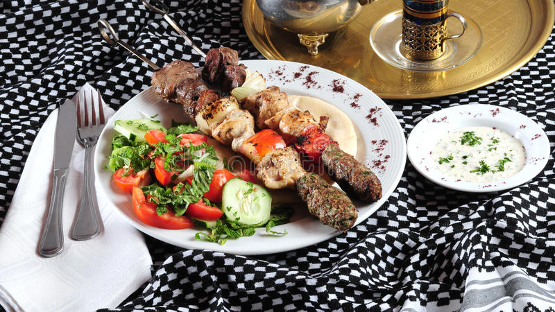Mixed shish kebab. Middle eastern cuisine royalty free stock photos