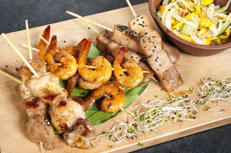 Mixed skewers, chicken, fish and cow meat. Mixed skewers, chicken meat, fish cow and shrimp stock photos