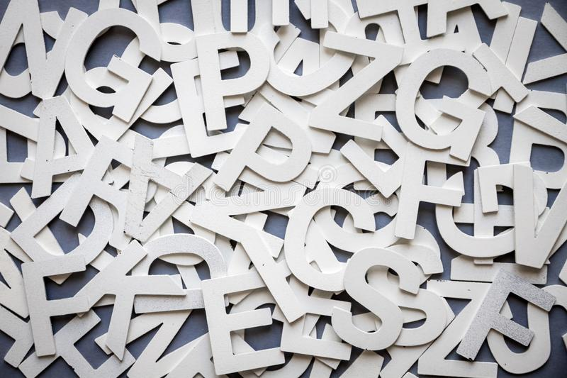 Mixed letters pile top view photo. Mixed solid letters pile top view photo. Education background concept stock image