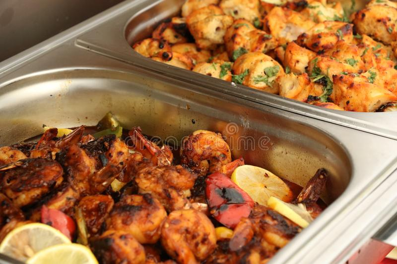 Mixed spicy Grilled Prawn Fry with lemon sliced on a steel tray in restaurant , Dubai,UAE ON 21 JULY 2017. A traditional red chilly powder with garam masala royalty free stock images