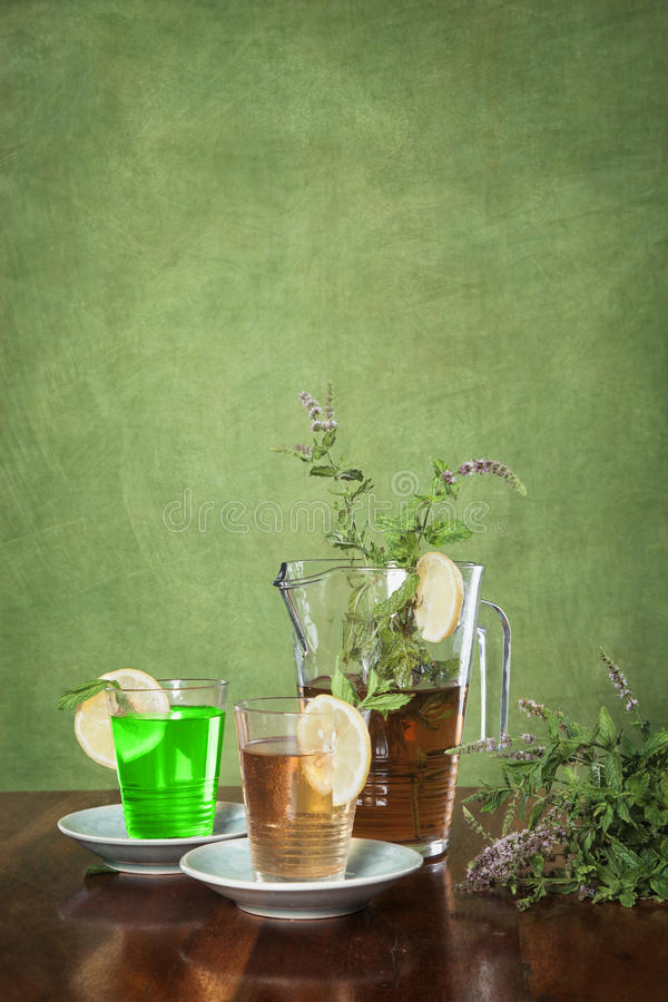 Mixed tea with herb bouquet. And glasses stock photography