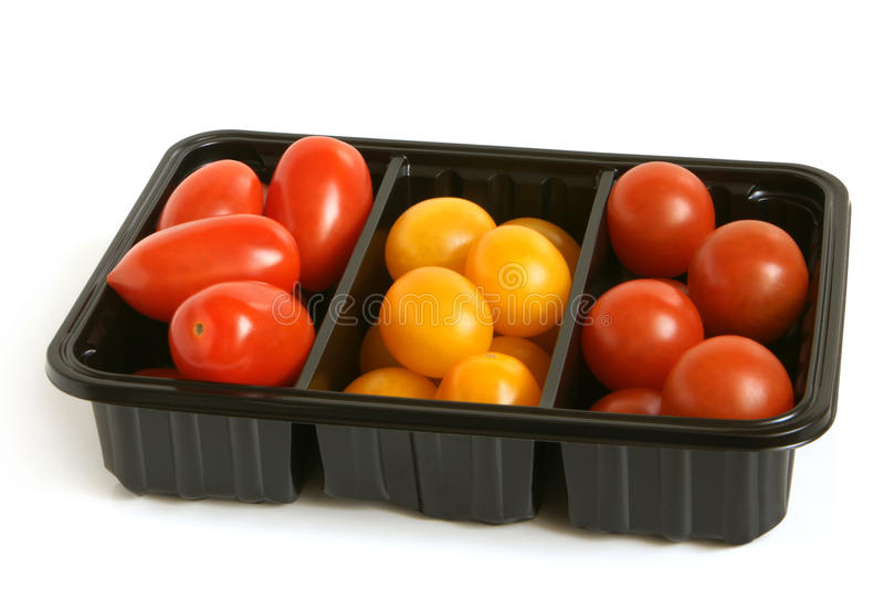 Mixed tomatoes in box. On a white background royalty free stock photos