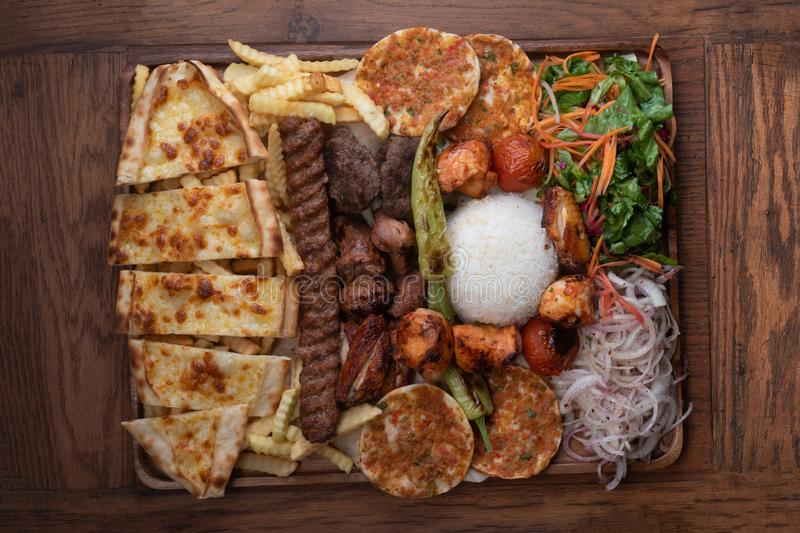Mixed turkish kebab plate on wooden background stock photo