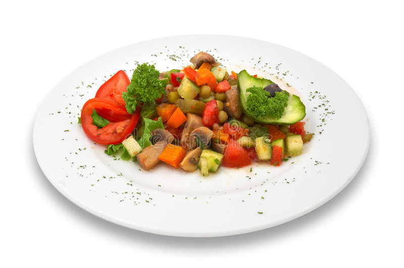 Mixed vegetable/mushroom salad. isolated. Mixed mushroom and fresh vegetables salad served on plate. isolated royalty free stock image
