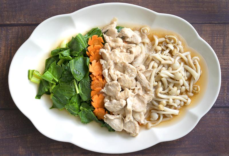 Mixed vegetable stire-fried with chicken,kale,carrot,mushroom,healthy food,Thailand food. stock photo
