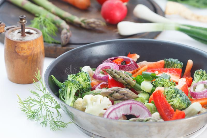 Mixed vegetables with carrots, broccoli, cauliflower and asparagus royalty free stock image