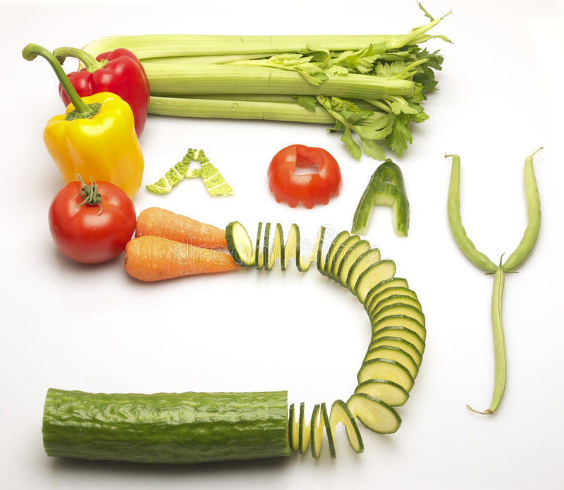 Mixed vegetables spelling out the words, 5 a day royalty free stock image
