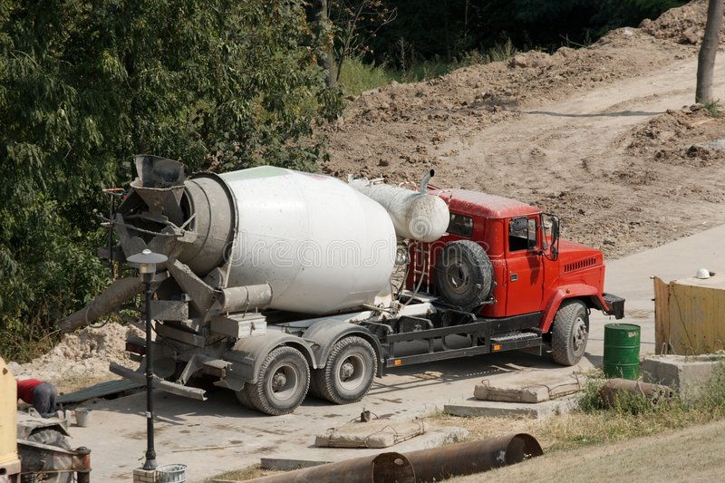 Mixer. Concrete mixer truck at a construction site royalty free stock images