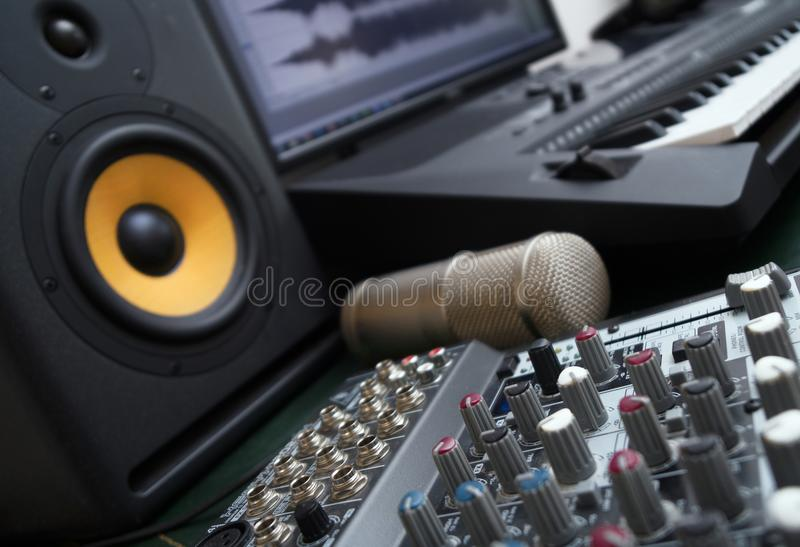 Concept of home music studio. Mixer, condenser microphone and professional monitor. Concept of home music studio royalty free stock image