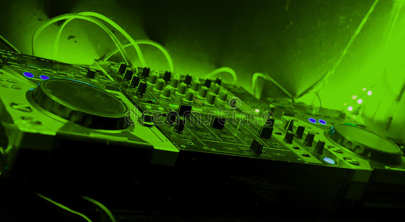 Mixer with green tones in night party royalty free stock photos