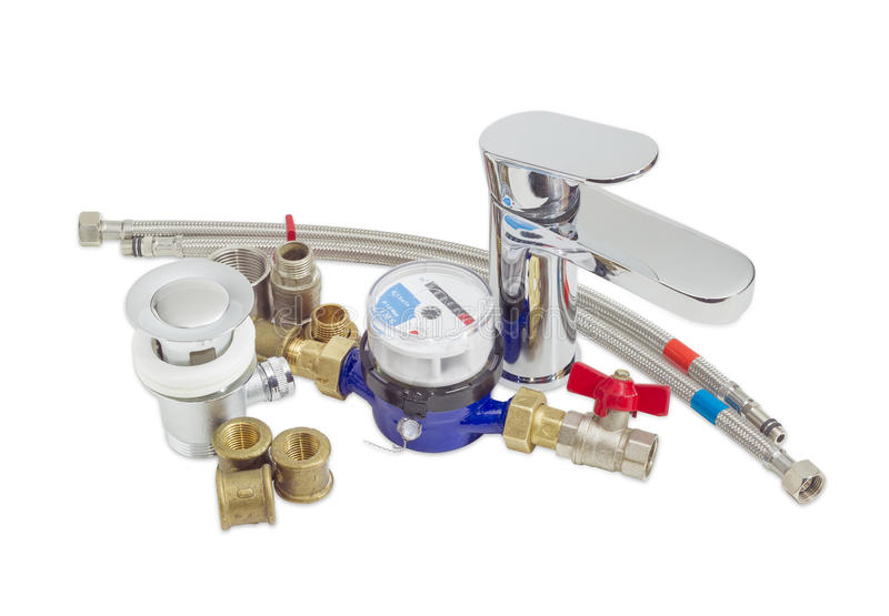 Mixer tap, water meter and some plumbing components. Single handle mixer tap, water meter and some plumbing components on a light background stock photography