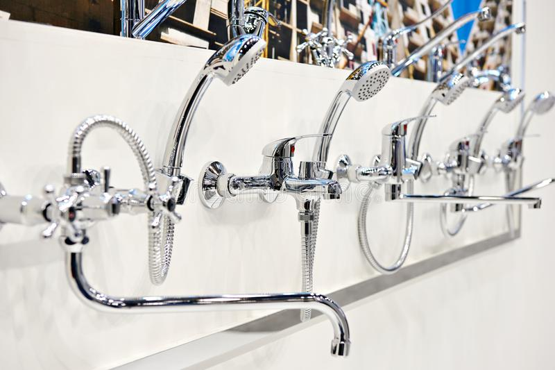 Mixers taps for shower in store stock image