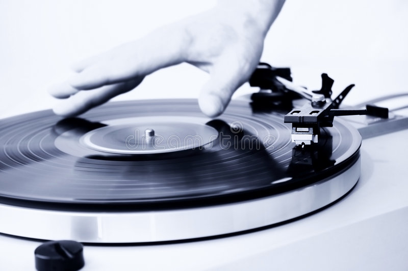 Mixing. Man's hands spinning a vinyl record. Focus on the needle head stock photos