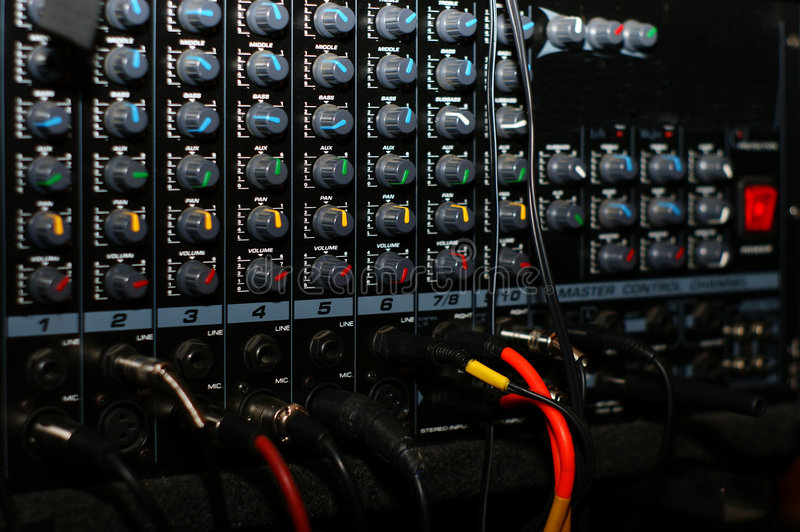 Mixing board, detail. Music accessories stock images